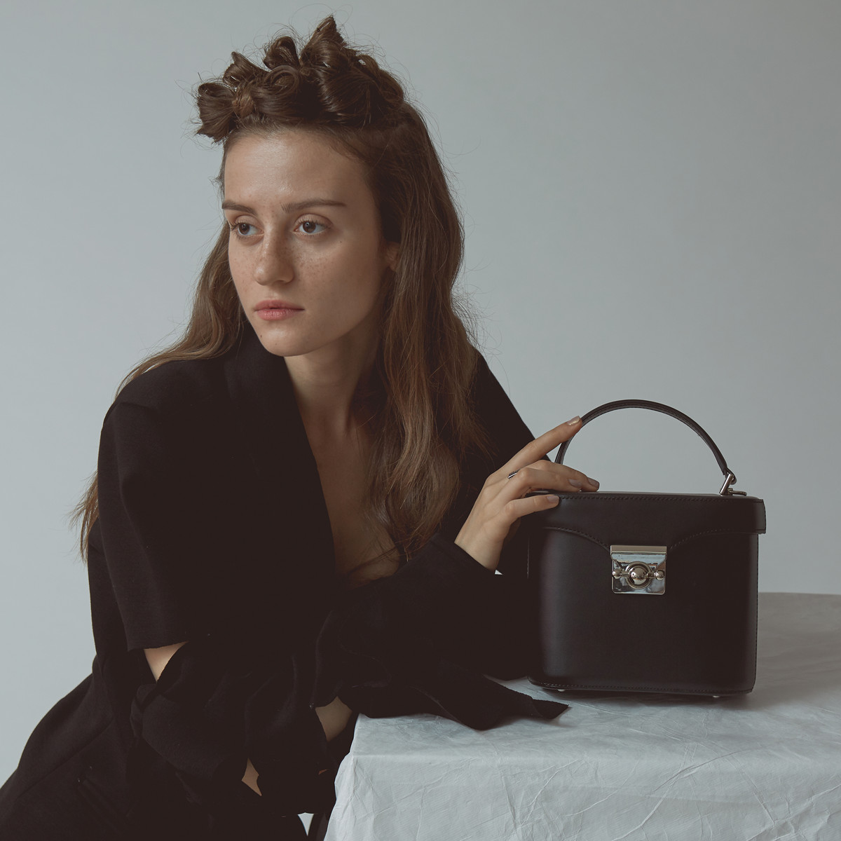 Unique Designed Bucket Bag with a planet shaped locker. 100% leather with high quality.